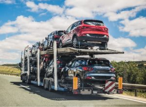 Car transporter moving on a road.